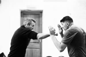 men fighting using krav maga technique